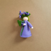 Seasonal doll violet with flowers in her hand