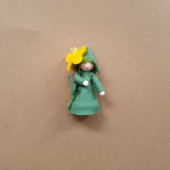Seasonal doll Common Celandine with flowers in her hand