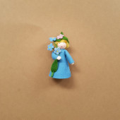 Seasonal doll forget Me Not with flowers in her hand
