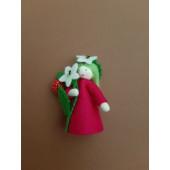 Seasonal doll with raspberries  in her hand
