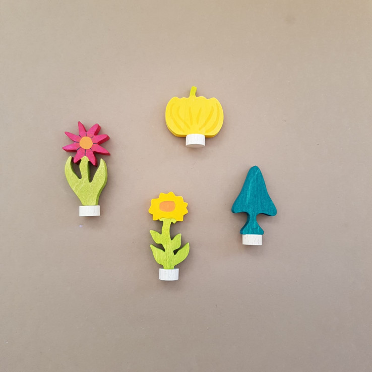 Figurines with plants flowers and trees
